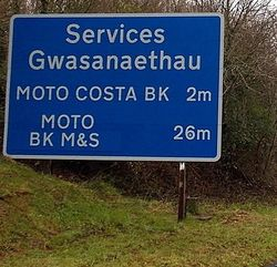 Moto Motorway services sign in Wales.